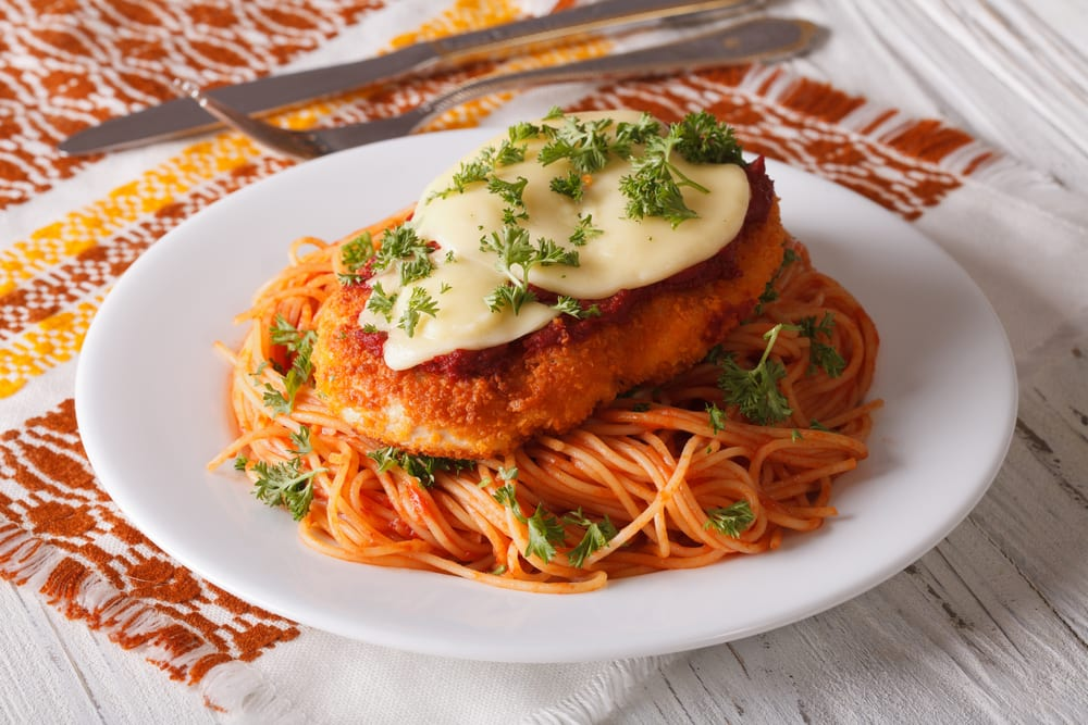 Bookmark this list of Italian catering ideas so that you remember to order dishes like this one, chicken parmesan.
