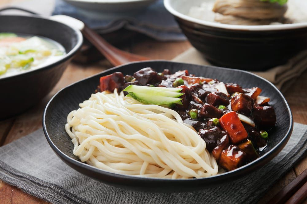 Dazzle your next meeting with Korean catering ideas like this one, noodles with black bean sauce.