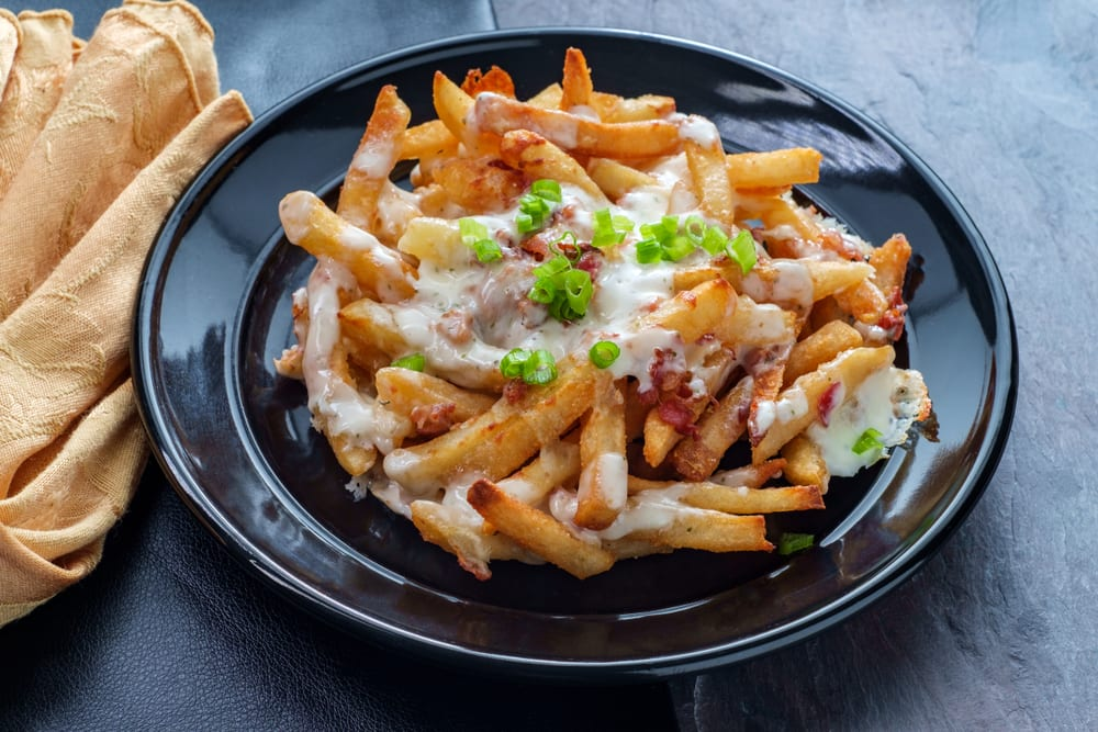 If you need creative catering ideas for a casual team lunch, try these fries loaded with kimchi and other Korean foods.