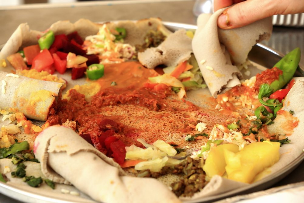 Ethiopian injera piled with stews and sauces.
