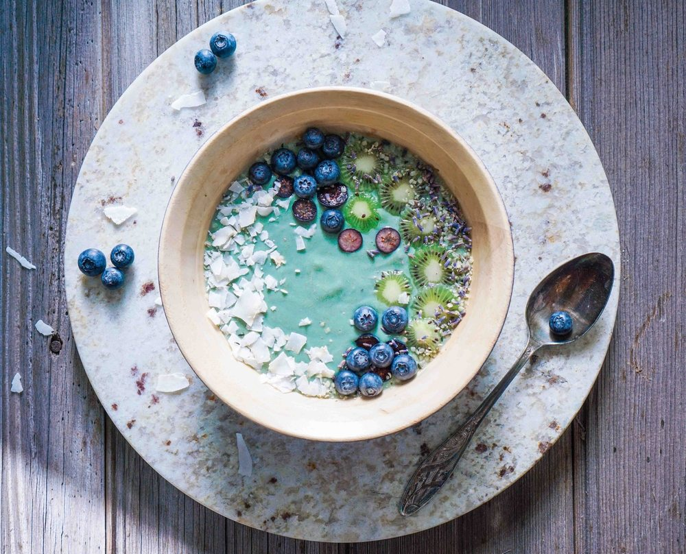 Breakfast bowl with spirulina, coconut, and blueberries.