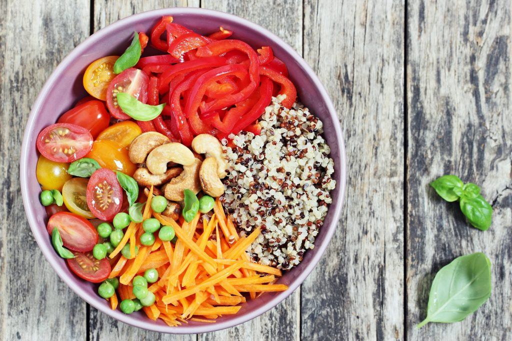 Grain bowl with fresh vegetables over quinoa.