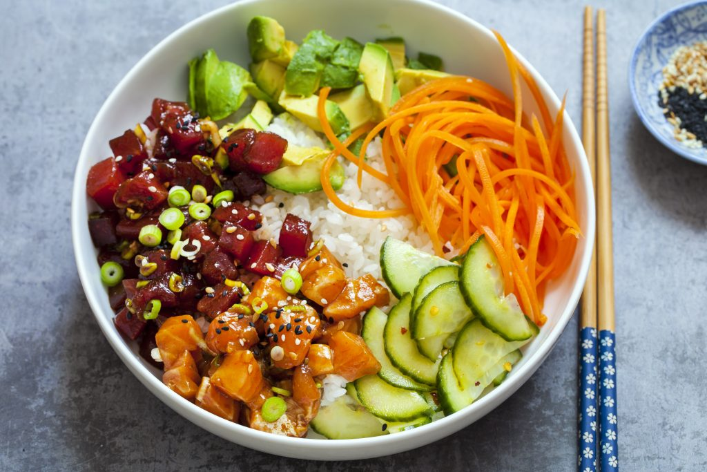 Poke bowl with tuna and vegetables over rice.