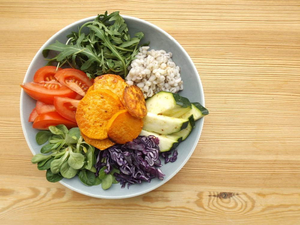 Buddha bowl with fresh vegetable toppings